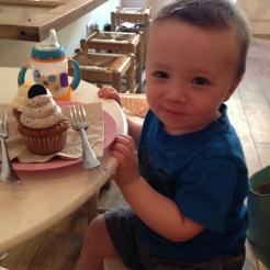 Birthday boy enjoying his oreo cupcake!