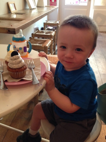 Birthday boy enjoying his oreo cupcake!