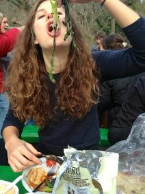 Hannah eating her calçots!